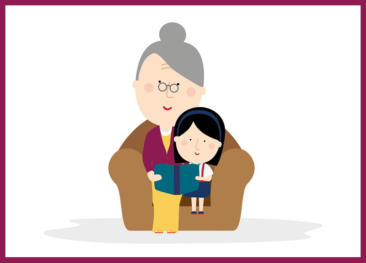 Kindje zit naast oma op de bank, oma leest een verhaal voor.