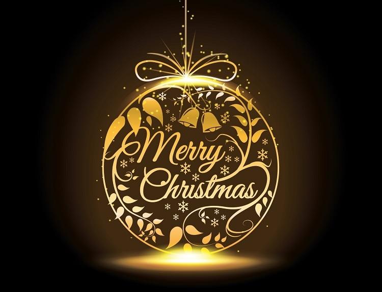 Elegante gouden kerstbal met daarin de wens 'Merry Christmas'