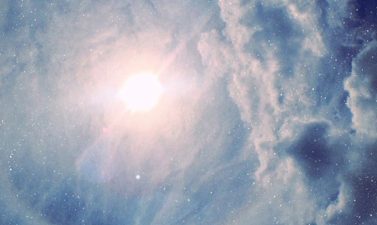light cloudy sky with the sun shining through